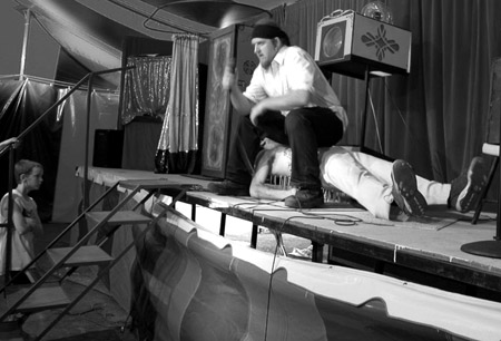 Freakshow Foley on the bed of nails with Ses Carny applying extra pressure (This photograph is © 2005 by James G. Mundie; reproduction without express permission is prohibited.)